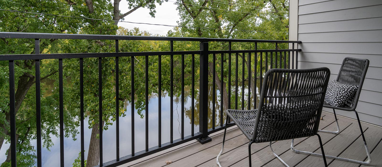River view from patio with chairs