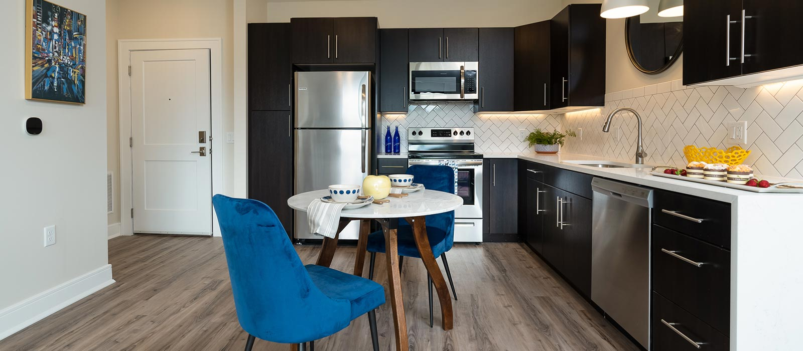 Modern kitchen with dark wood cabinets and modern table and chairs