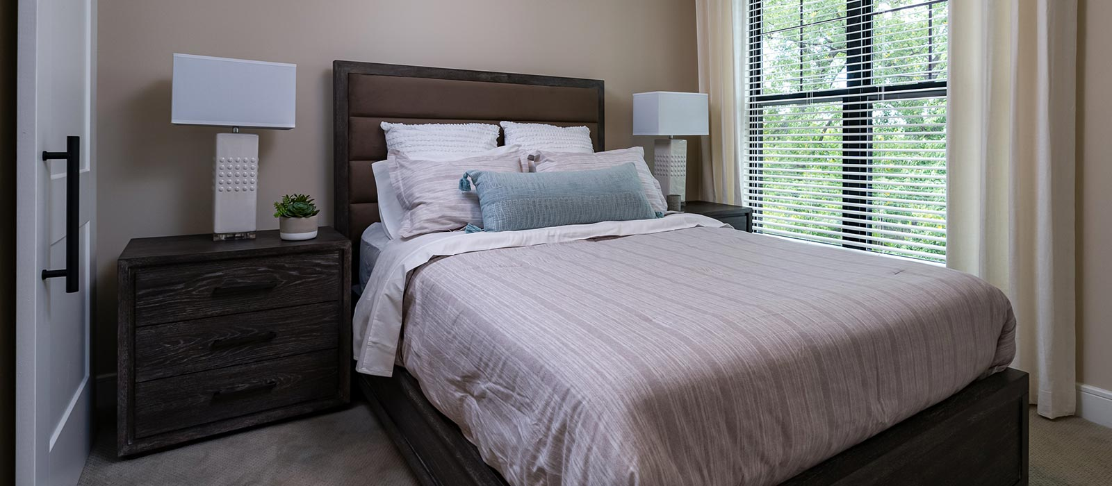 Modern bedroom with conformable bed and large window