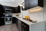 White counter tops on dark wood cabinets