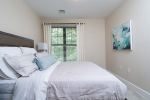 Bedroom with comfortable bed and wall art