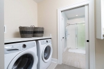 laundry room adjacent to bathroom