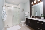 class shower with wood vanity