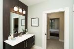 bathroom with dark wood vanity