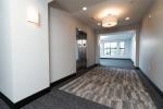 Carpeted hallway near elevator
