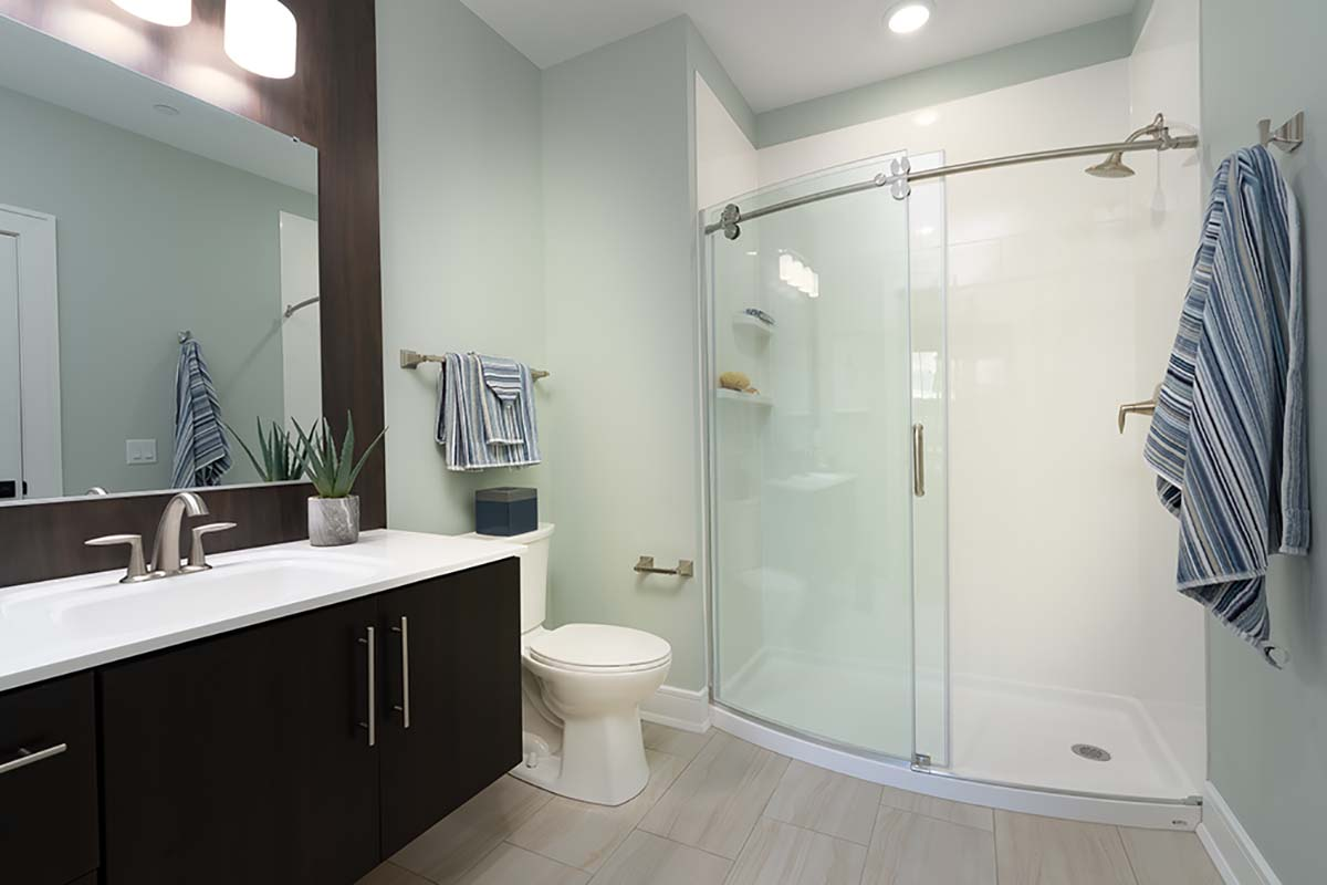 Glass enclosed shower in bathroom