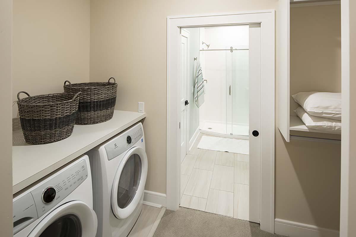 laundry room looking into bathroom
